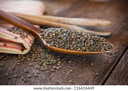 French lentils in a wooden spoon