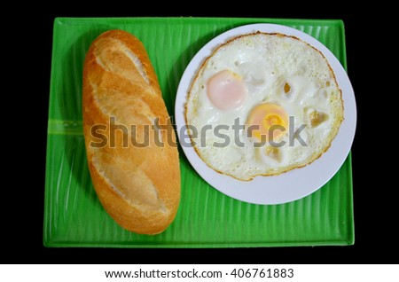 French loaf or baguette served with fried egg in breakfast time