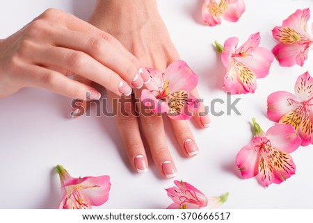 French lunar manicure with beautiful pink freesias.