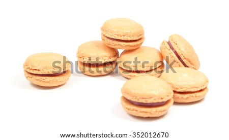 French macarons stuffed with raspberry filling on a white background. - stock photo