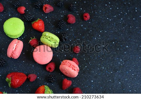 French macaroon and berries, top view,  , food closeup - stock photo