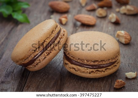French macaroons and almond on table