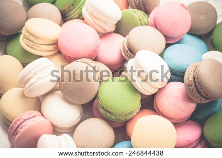 French macaroons. Coffee, chocolate, vanilla and raspberry macaroons, vintage tone - stock photo