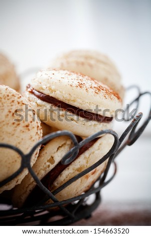 French macaroons with chocolate filling and cocoa powder - stock photo