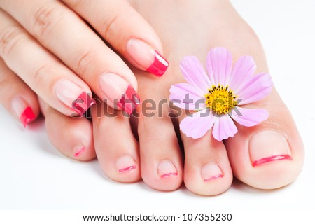 french manicure and pedicure  relaxing with flowers - stock photo