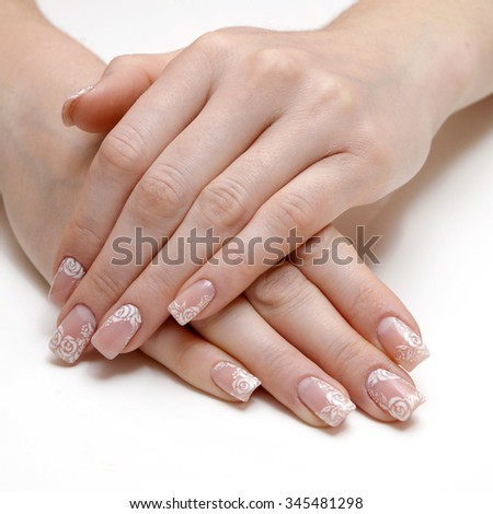 french manicure and roses