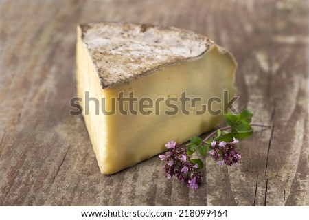 French mountain cheese - Tomme de Savoie cheese - stock photo