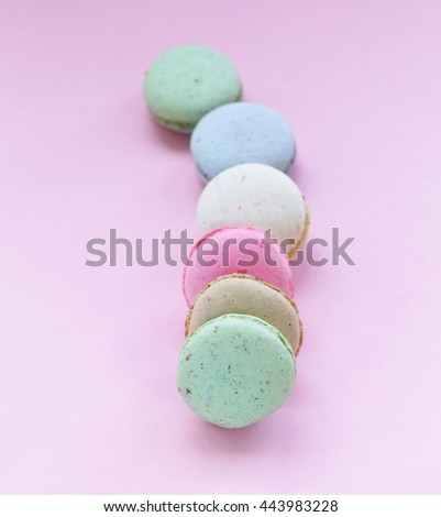 French multicolored almond cookies macaroons on a pink background - stock photo