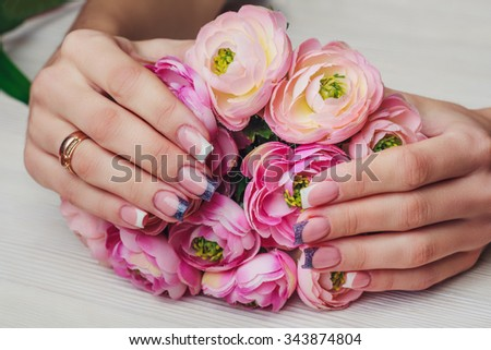 French nail art in purple color on wooden background