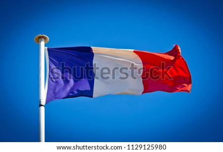 French National Flag blowing in the wind showing tricolour.