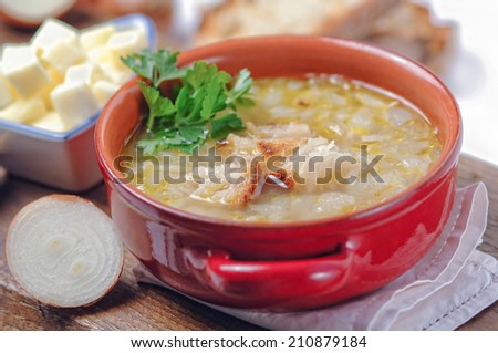French onion soup in a red bowl - stock photo