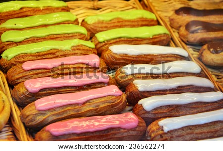 French pastry glazed Eclairs with cream and chocolate. Variety Selection - stock photo
