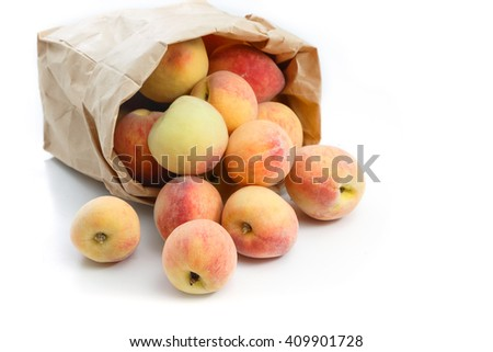French peaches in paper bag isolated on white - stock photo