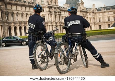 french policemen in bike in Paris - stock photo