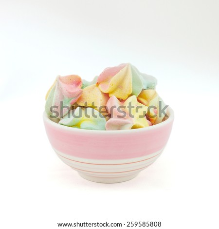 French rainbow meringue cookies on white background with copy space. Macro with shallow dof. - stock photo