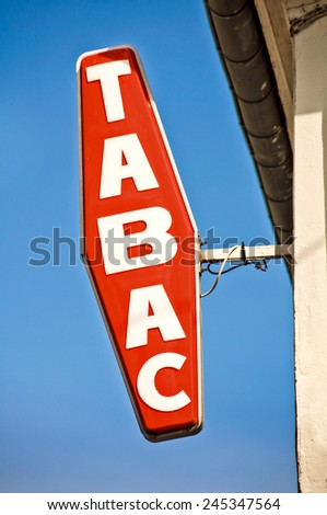 "French red and white sign ""tabac"", meaning tobacco in French"