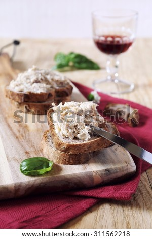 French rillettes: meat pate with bread and glass of red wine