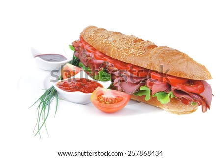 french sandwich : baguette with smoked sausage with sauces and chives isolated over white - stock photo