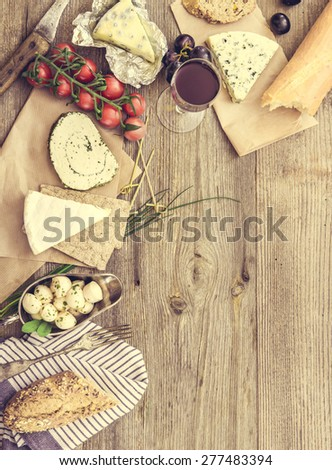 French snacks on a wooden table with space for text - stock photo