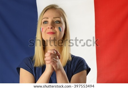 French soccer fan cheers football team in the national colors. MANY OTHER PHOTOS FROM THIS SERIES IN MY PORTFOLIO. - stock photo