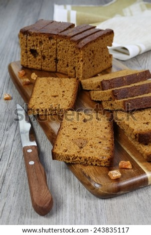 French spice bread, knife and dried fruits