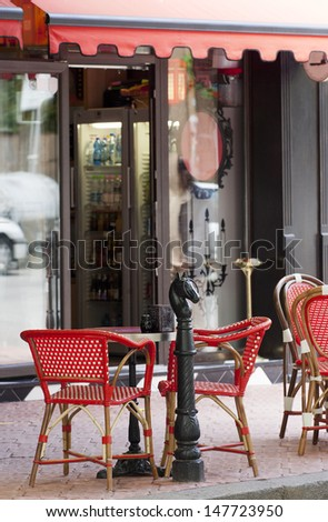 French style cafe with red shelter. - stock photo