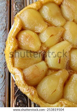 French Tarte Tatin  with pears and caramel - stock photo