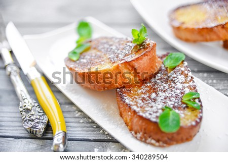 French toast -  fried bread toast with powdered sugar and mint