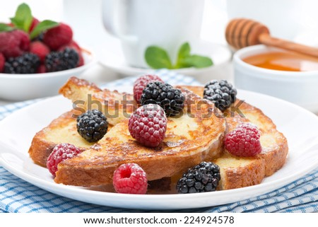 French toast with berries and powdered sugar, horizontal - stock photo