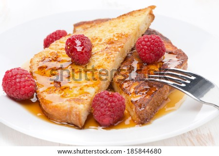 French toast with raspberries and honey, close-up, horizontal