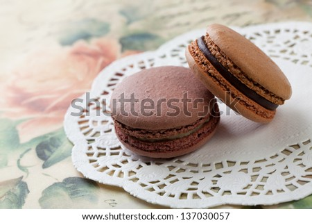 French traditional dessert macaroons on vintage background