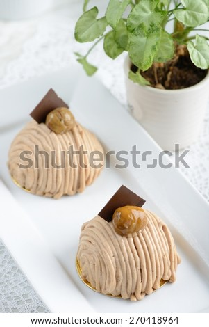"""French traditional """"Mont Blanc"""" desserts with chestnuts and cream - stock photo"""