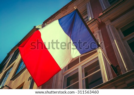 French Tricolours Flag Decorate A Local Government Building In Paris, France. Toned, Instant Photo - stock photo