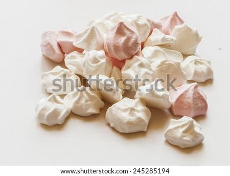 French vanilla meringue cookies on white background - stock photo