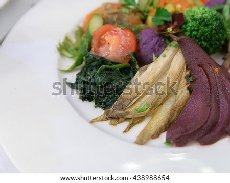 French vegetable dishes bbq grilled side dish appetizer food with Sauteed Spinach, Tomato, Broccoli, Asparagus, Cucumber, Bell peppers, Zucchini Salad in Paris, France. Selective Focus - stock photo