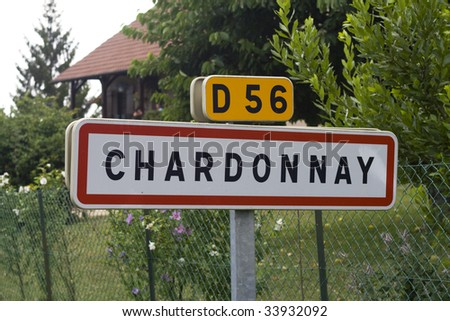 French village roadsign of Chardonnay. Chardonnay is one of the most famous white wine grapes in the whole world. - stock photo