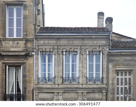 French windows in Bordeaux. Traditional windows in a traditional old building in Bordeaux.