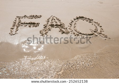 Frequently ask question concept, word faq written on beach  - stock photo