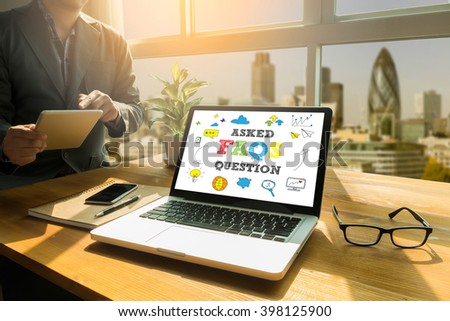Frequently Asked Questions Faq Feedback  Concept Thoughtful male person looking to the digital tablet screen, laptop screen,Silhouette and filter sun - stock photo