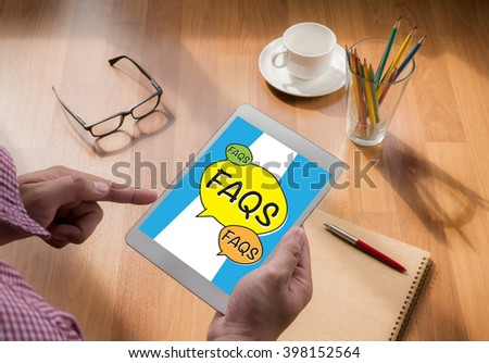 Frequently Asked Questions Faq Feedback  Concept touch digital tablet, coffee - stock photo
