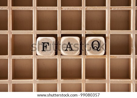 Frequently asked questions or FAQs letter cubes with a shallow depth of field