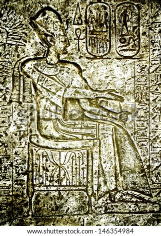 Frescos and hieroglyphs on a wall of the Egyptian temple - stock photo