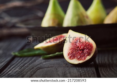 Fresg figs on wood. Fresh fruit on black