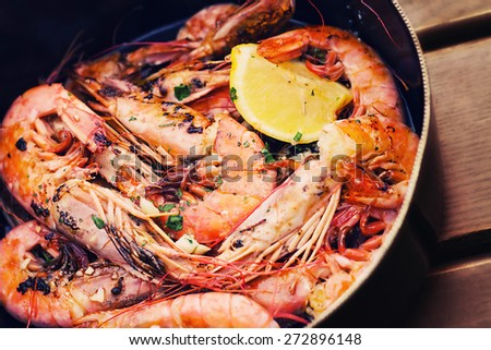 Fresh Adriatic shrimp served in buzara sauce (shallow dof) - stock photo