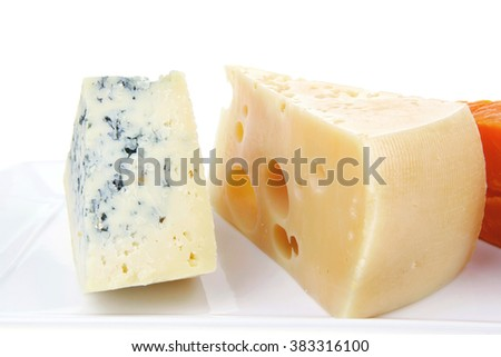 fresh aged french cheese parmesan roquefort and gruyere chops on white plate with isolated over white background - stock photo