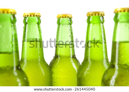 Fresh alcohol drink in the bottles with green bottles, isolated over white background - stock photo