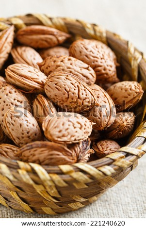 Fresh almonds in a basket - stock photo