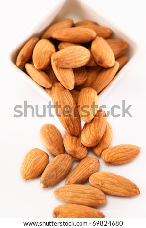 Fresh almonds on white - stock photo