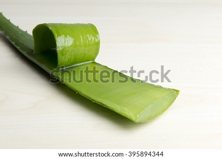 Fresh Aloe Vera slices on wood background - stock photo