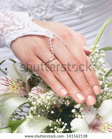 Fresh and beautiful wedding bouquet in bride's hands